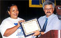 Damaris Santana with Bob Kingsley and the Charter for UE Local 1166