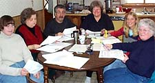 The Local 278 Negotiating Committee Works on the Contract ...