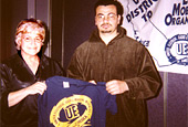 District 10 Pres. Marianne Hart presents a T-shirt to Local 1421-Kraco negotiating committee member Luis Hernandez