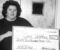 Carol Watchorn received the largest individual back pay check from the State of Iowa