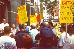 Alderman Rick Mu�oz addresses a rally outside the GATX headquarters in downtown Chicago